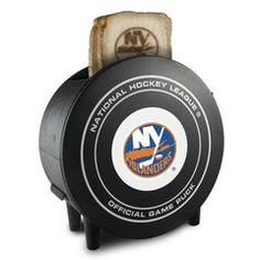 The NHL ProToast MVP Toaster boasts an eye-catching hockey puck shape with 2 slots on top and an official pro hockey team logo on the outside. It has adjustable toast settings and toasted bread comes out with your favorite team's logo. Pro Hockey, Hockey Puck, Hockey Teams, Nhl Shop, Nhl Boston Bruins, New York Islanders, New Jersey Devils, Los Angeles Kings, National Hockey League
