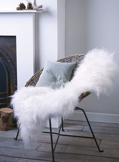 Rattan chair and Icelandic sheepskin by Cox & Cox | Lounge wishlist | These Four Walls blog