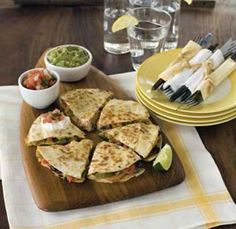 Try layering shredded roasted chicken, pulled pork, or sliced skirt steak with the onions and peppers in these quick and easy stovetop quesadillas. For vegetarians, sautéed mushrooms are a great addition, too.