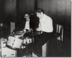 Elvis Presley - June 30, 1956 - Mosque Theatre, Richmond After the first show was over, somebody gave him a Pepsi, soon, the momentum of his nervous energy sent him back to center stage where he sat down and started playing with the drums. A reporter in bowtie and glasses pulled up a chair and asked questions....Elvis fiddled with the drumsticks/// 'I can't play', he drawled. 'I learned this when I was in the ROTC in a Memphis High School'