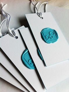 A coloured wax seal on contrasting card stock makes a fun and different business card