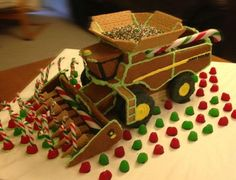 Enjoy this #gingerbread combine by John Deere employee Steven Reynolds. Uses gingerbread, graham crackers, sugar cones, icing & candies. Not sure if tires are cookies or frosted gingerbread.