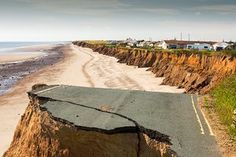 A collapsed coastal road between Skipsea and Ulrome on Yorkshire's east coast, UK