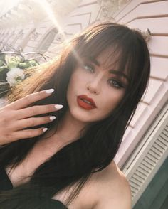 Beauty | Hair | Brown hair with bangs | Long hair | White nails | Red lipstick | Bangs | How to wear your bangs | More on Fashionchick