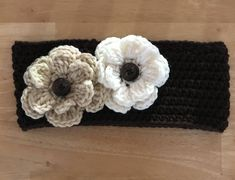 Teen/Adult Size Handmade crochet Ear Warmer or Headband Machine washable and dryer safe. Dark brown with one off white flower and one beige flower. The flowers have a button in middle. If you want one made in another color please contact me. Ear Warmer Headband, Ear Warmers, White Flowers, Off White, My Etsy Shop, Beige, Crochet, Hats, How To Make