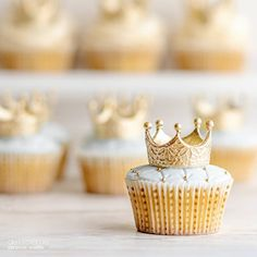 lets make cupvakes that have a gold wrapper and lets buy the toppers of crown or cross