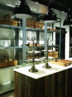 Danish kitchen: garage-style metal shelving & reclaimed wood for the island.