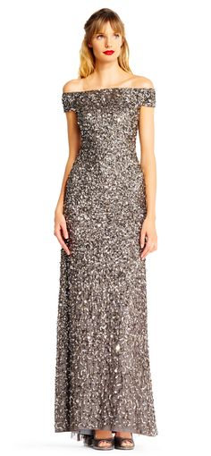 Sequin design is beautiful.  Not too different from background fabric color.  Do not care for high/low.  Prefer 1/2 length sleeve.  Neckline is nice!