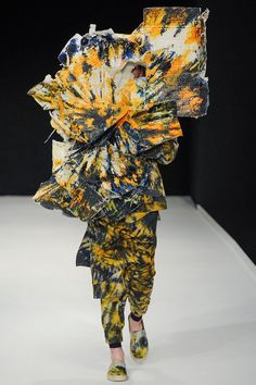 Yes, this is real. Designer Craig Green is apparently known for hiding his models' faces and making them wear these monstrosities down the runway.  Um. I hope he doesn't trip and fall. :-