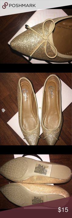 Who needs GOLD shoes 🙋🏼 Brand new with the box perfect gold shoes. I bought these to wear at my sisters wedding last night and never even put them in the car to take to the wedding lol. They are so cute! They are perfect to change into at the reception to still look great but comfortable enough to dance the night away. Candie's Shoes Flats & Loafers
