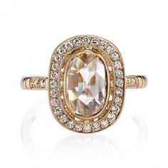 Single Stone Camille USD $11,500 1.30ct M/VS2 GIA certified Oval Rose cut diamond set in a handcrafted 18k rose gold mounting. A halo design featuring a bezel set diamond, low profile, and intricate gallery.