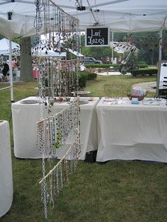 necklace display - wood poles slid through chain hole