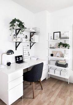White study area // white desk and shelves with black brackets // black mid century desk chair, plant on shelf