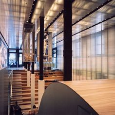 """Prada shop, SOHO NYC  Rem Koolhaas  Zebrawood """" wave""""   2 story high, curved on one side,   stepped on other"""