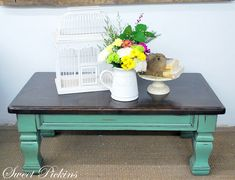 coffee table  - teal and distressed  Like this option. Keep chairs black.