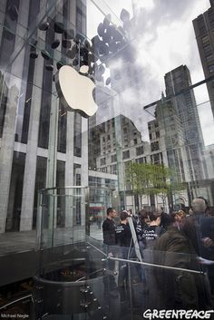 """April Photo of the Month - Michael Nagle shows the above ground entry way of Apple's 5th Ave. store in NYC after Greenpeace activists released black balloons with the message """"Clean our Cloud"""""""