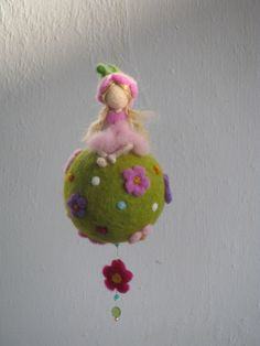 Waldorf inspired needle felted spring - fairy sitting on a ball by Made4uByMagic on Etsy https://www.etsy.com/listing/122649303/waldorf-inspired-needle-felted-spring
