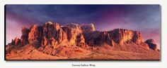 "Large panoramic gallery wrapped canvas photograph of Superstition Mountains during sunset in Apache Junction Arizona sized 19"" x 50"" with 1.5"" deep black sides. Panorama wired ready to hang. Image title: Superstition Mountains This image is from my collection of Southwest landscapes and shows beautiful mountains and tall saguaro cactus near Phoenix, AZ. All photographs are original and photographed by artist Bob Estrin. Print details: Printed at a professional lab Archival pigmented…"