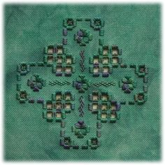 Flodgarry - this design makes the most of the blues and greens in the variegated threads used. The chart pack includes a large and a small version.