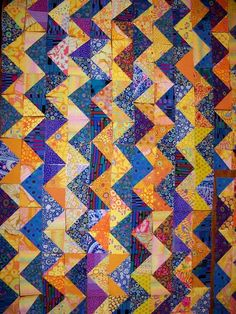 I've made some more progress on my zig-zag quilt. Its so much fun to do, that my hexagon quilt will have to wait. There is currently a Zig-Zag QAL being hosted by Smazoochie. Triangle Quilt Pattern, Half Square Triangle Quilts, Hexagon Quilt, Quilting Board, Quilt Making, Pin Cushions, Zig Zag, Quilt Patterns, Chevron