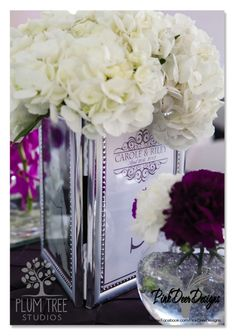 Plum and Platinum Wedding Décor, Centerpieces, Table Numbers by PinkDeer Designs. Photography by Plum Tree Studios