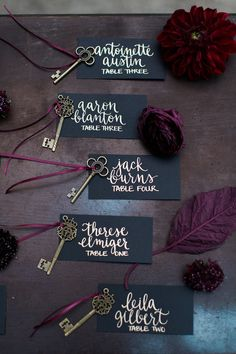 Black and gold wedding inspiration Gold calligraphy escort cards