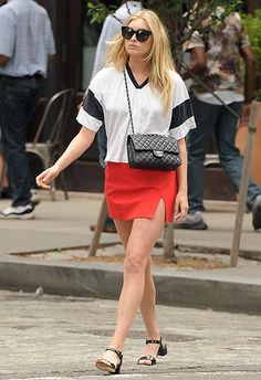 Make like Elsa Hosk and team a red miniskirt with an oversized varsity-style tee. Let the summer vibes sing with patent sandals, cat-eye sunnies and a chain cross-body bag