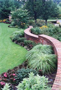 Custom Curved Brick front wall - elegant entry - Redbud Development
