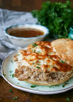 slow cooker shredded pork french dip sandwiches are easy and delicious! Lean shredded pork topped, bubbly provolone, and savory au jus are a killer combo. | slow cooker shredded pork french dip sandwiches | a flavor journal
