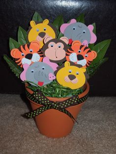 Adorable Jungle Theme Baby Shower Centerpiece. Alter cutouts to include more animals. #animalthemed #babyshower