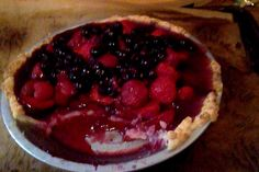 strawberry pie, with fresh uncooked local strawberries, raspberries. The filling of blueberries, sugar, corn starch, spices (nutmeg, cardamom, cinnamon, star anise, cloves, vanilla bean...) is cooked til bubbly; soaked gelatin leaves then stirred in; cooled, then poured over fresh fruit, chilled overnight to set. Delicious cold pie! because: summer:)