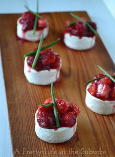 Cedar Planked Fruit & Wine Brie Bites {A Pretty Life}  |  These little bites are bursting with flavours of the buttery Brie, the fresh berries, the wine and the slight flavour of the cedar plank.  They are ah-mazing!