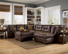A Favorite so far. Living room leather sectional couch. Love the wall color