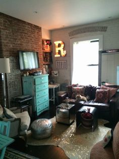 Rachel's West Village Nest via apartment therapy; I like the teal chest of drawers with TV on top
