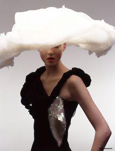 Yohji Yamamoto. Looks like she has her head in a cloud :)