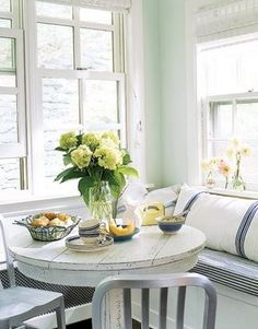 Idea for window seat by bay window in kitchen.  Love the blue/grey chairs with white round table. by estela