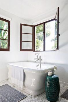White bathroom with dark wood window sills