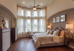 Master Bedroom: A bow window is the highlight of the room. It accentuates the view by dividing it into different planes. It also brings in more light and gives a feeling of spaciousness to a room. Damask bedding in muted taupe draws the color in from the walls. Darker pillows in the same color family add depth. Darker tones are also echoed in the furniture.