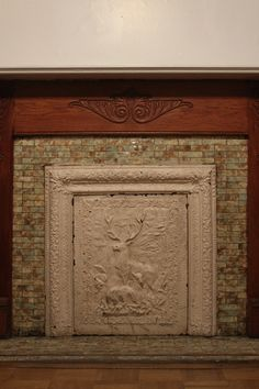 Fireplace with vintage tile and cast iron cover in the master ...
