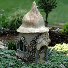 This charming English Fairy Cottage is hand-sculpted by artist Mary Sallee Stams.