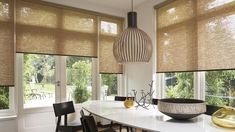Beautiful contemporary looking dining room with natural and rustic colors. Cool lamp too! Love it!