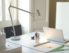The fully adjustable structure makes the Polo LED Table Lamp by Marset a super cool accessory for your workspace.