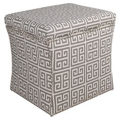 Invite guests to sit in the living room or stow spare linens in the den with this lovely storage ottoman, showcasing Greek key-print upholstery and a pine wo...