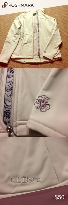 Super cute L.L. Bean jacket Comes from a smoke free home - fleece lined with cute flower details - hooded- flattering fitted style NWOT no stains or s ohms of wear - color is a pearly gray taupe L.L. Bean Jackets & Coats