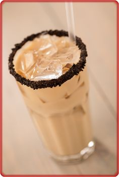 The Dude: A signature White Russian with Vodka, Kahlua and milk served in a tall glass with an Oreo cookie crumb rim.