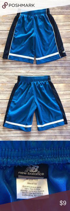 New Balance Athletic Shorts Royal blue athletic shorts with an inner drawstring waist and side pockets. Labeled sz 10/12. EUC. 11711 New Balance Bottoms Shorts