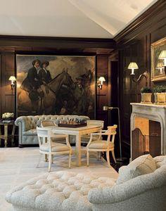 Designer William Hodgins installed dark wood paneling in his Virginia home's family room {via House Beautiful