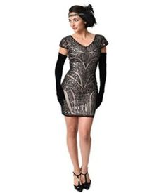 An opulent and flashy flapper frock in a modern silhouette, this vintage style dress is cut in a fitted and soft black beaded and sequined mesh tulle over nude knit lining. With scintillating gunmetal sequin structure in a gorgeous jazz age de 1920s Cocktail Dresses, V Neck Cocktail Dress, Vintage Party Dresses, Sequin Cocktail Dress, 1920s Dress, Gatsby Dress, Sequin Dress, Flapper Outfit, Beaded Flapper Dress