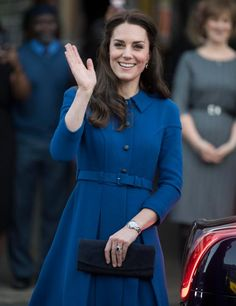Blue is her colour . . . Kate Middleton waves for fans in smart coat