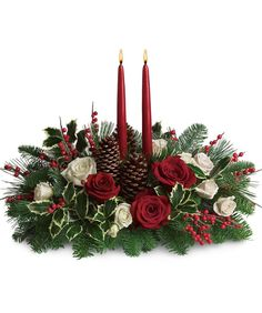 Beautiful red and white roses Two Candle Traditional Centerpiece - encompassed in evergreens, holly, red berries and pine cones. Perfect elegance for a holiday table.